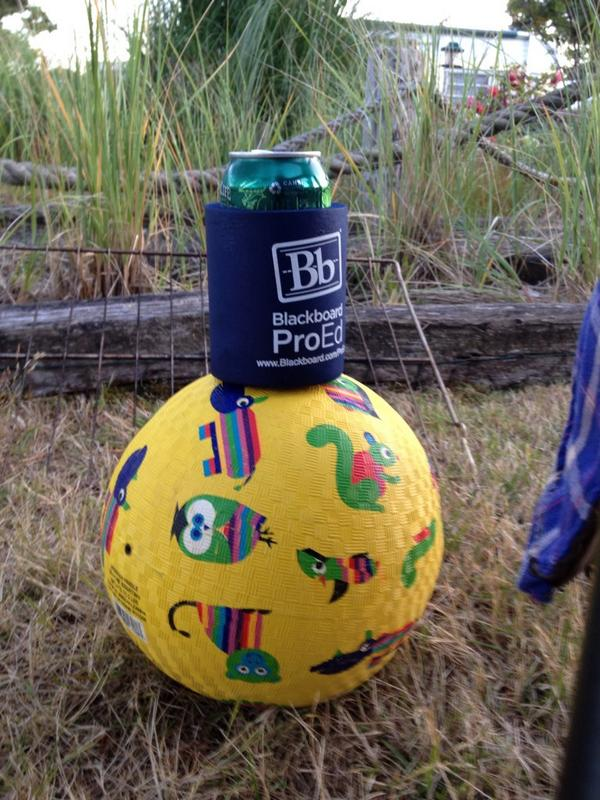 Tweet: A beer in a blackboard koozie on a ball at the bea…