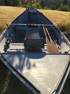 the front of an old aluminum drift boat