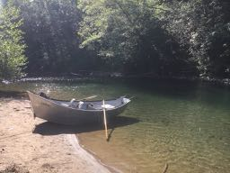 Shiny boat sitting on the bank of the Kalama river near Beginner hole